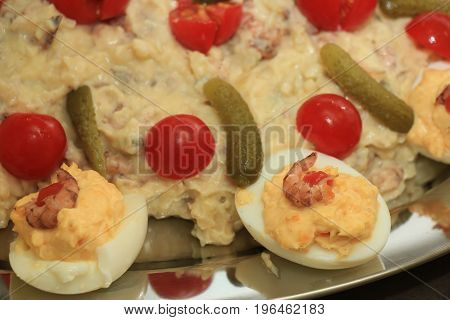 Olivier scrimp salad with pickles tomatoes and eggs