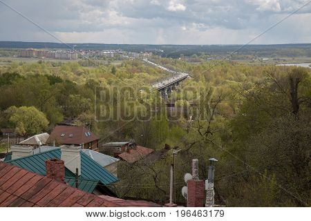 Village roofs park cars moving Vladimir Russia