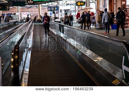 Female backpack walking escalator airport concept travel