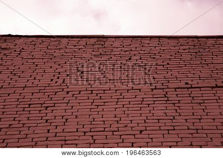 Red bricks wall grey sky texture absctact concept obstacle