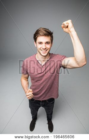 Muscle Man Hands Up Show Muscle Posing In Studio Isolated Over A Grey Background