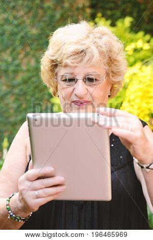 Elderly Woman Using Tablet.