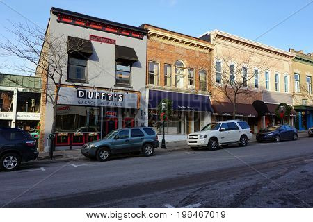 PETOSKEY, MICHIGAN / UNITED STATES - NOVEMBER 22, 2016: One may eat a gourmet meal at Duffy's Garage and Grille, and purchase clothing at Harbor Wear, on Lake Street in downtown Petoskey.