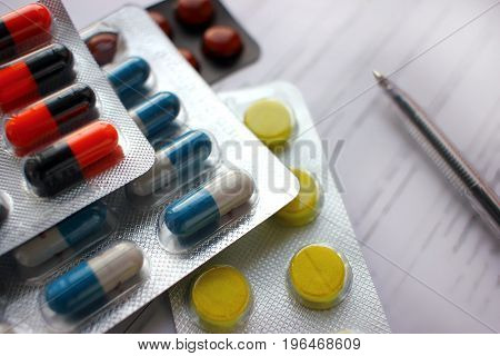 Many different colorful tablets in strips. Medications. Background of medicine from many capsules. Pharmacy.