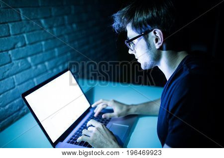 Man Using Laptop In The Night With White Screen Copy Space