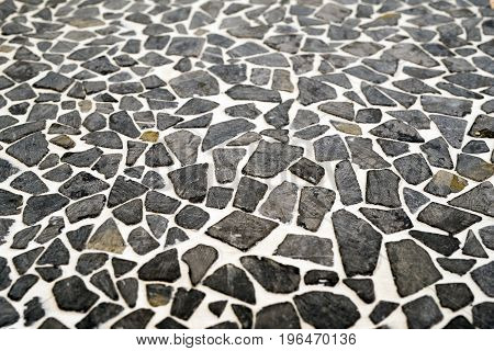 Stone flooring with black and white bits