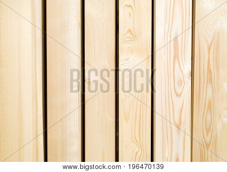 Wood beams standing side by side in a rack