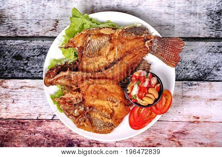 Deep Fried Tilapia With Spicy And Sour Herb Salad .