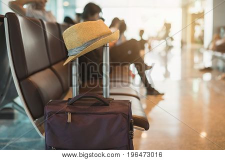 Travel suitcase in airport terminal and passenger background