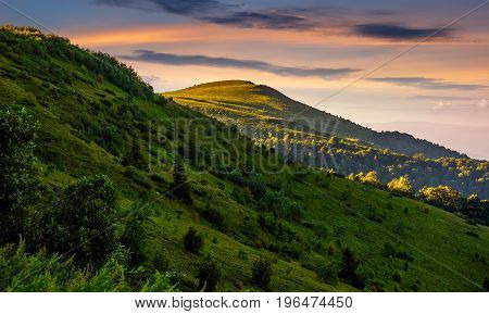 Mountain Ridge With Peak Behind The Hillside At Sunset