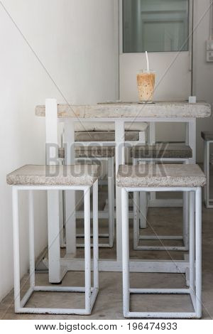 Iced coffee on concrete table top stock photo
