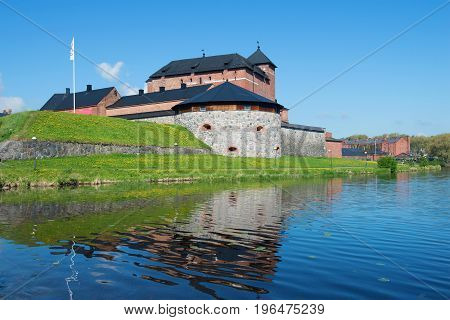 The fortress of the city of Hameenlina on the bank of the Vanayavesi lake in the sunny June afternoon. Finland