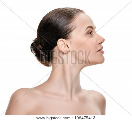 Side view portrait of healthy young woman with perfect neck