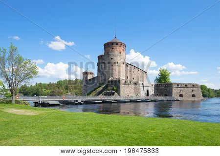 View of old Olavinlinn's fortress in the sunny June afternoon. Finland, Savonlinna