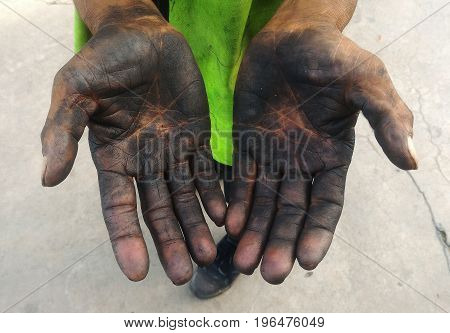 dirty hand of worker after work hard for along time