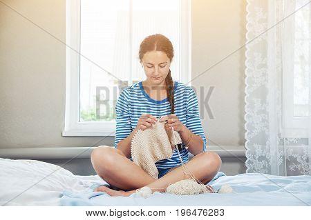 Woman Knits A Sweater