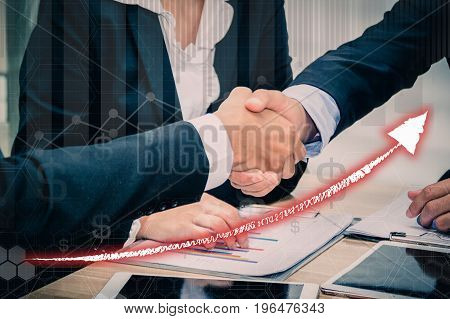 Business people join hands after meeting business goals.