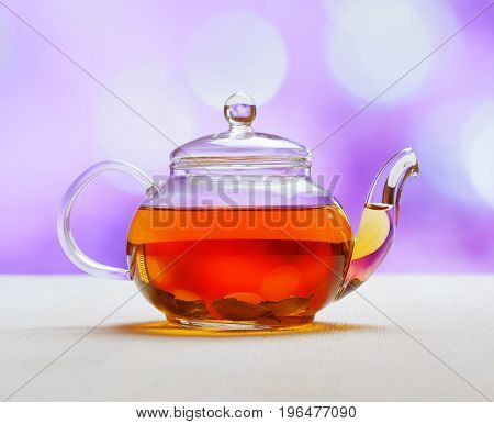 Teapot Of Fresh Tea On Purple Background