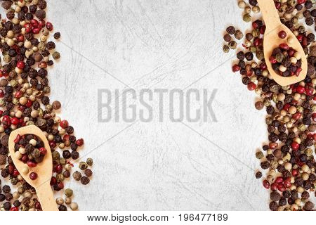 Close up mixed type of peppercorns on white grunge background top view or overhead shot