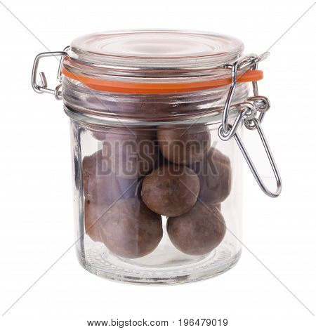 Macadamia Nuts In A Glass Bottle Isolated On A White Background