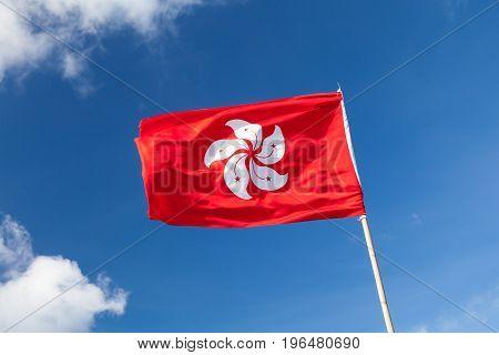 Hong Kong Flag Over Blue Cloudy Sky