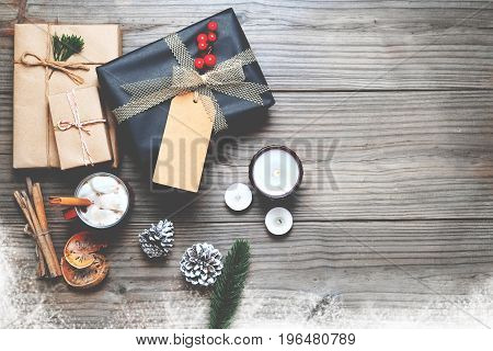 Christmas background - Christmas present gifts box and rustic decoration on vintage wooden background with snowflake. Creative Flat layout and top view composition with border and copy space design.