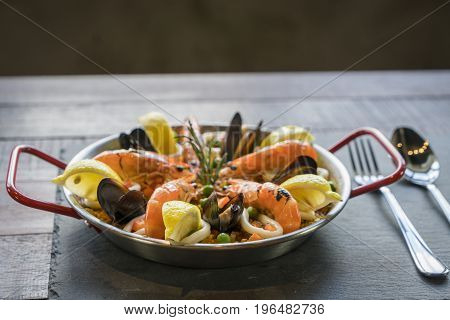 Paella With Seafood Vegetables And Saffron Served In The Traditional Pan