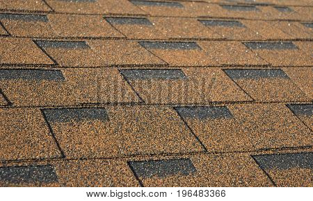 Asphalt Shingles Photo. Close up view on Asphalt Roofing Shingles Background. Roof Shingles - Roofing Construction Roofing Repair.