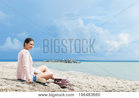 Woman Sitting Around  Sea