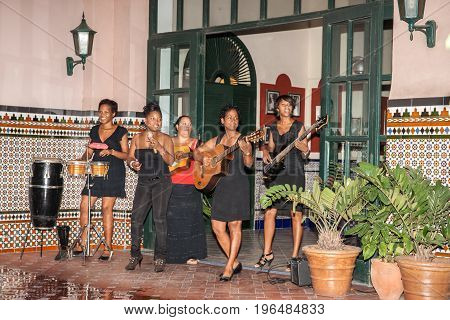 Havana, Cuba - June 29, June 2012; Entertainment Cuban style group five women musicians perform in entrance of hotel.