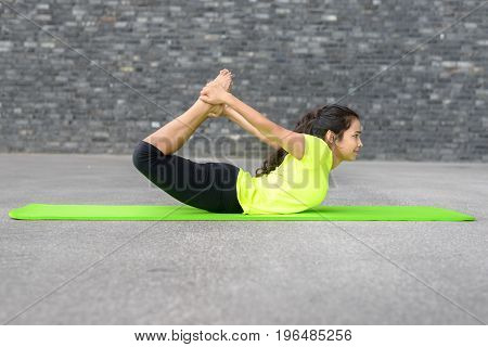 Attractive Young Woman Working Out In Town