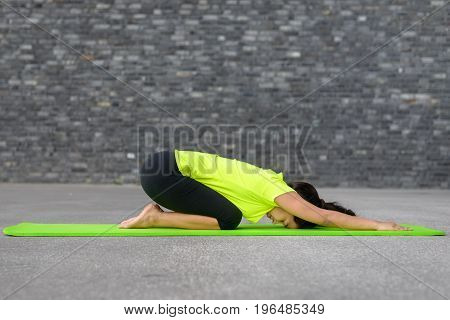 Supple Young Woman Working Out With Yoga