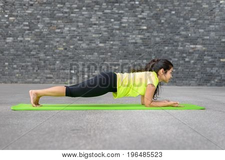 Young Athletic Indian Woman Working In With Yoga