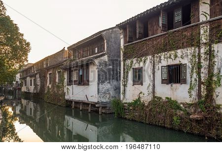 Suzhou, China - Nov 5, 2016: A row of residential house at the historic Zhouzhuang Water Town. These are located along a water canal channel.