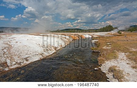 Iron Spring Creek and Cliff Geyser in Black Sand Geyser Basin in Yellowstone National Park in Wyoming United States