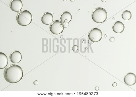 Flowing bubbles over a light gray background