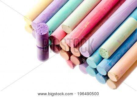 Chalk pieces - different colors and lengths reflected on mirror background