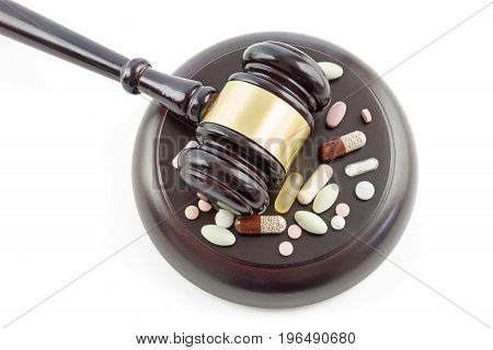 judge gavel and drugs tablets and pills top view from above isolated on a white background justice and medicine concept