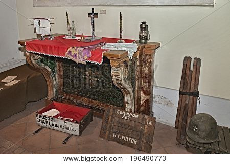 FAENZA, ITALY - NOVEMBER 2: old catholic altar and American portable chaplain set of world war 2 exposed during the town feast