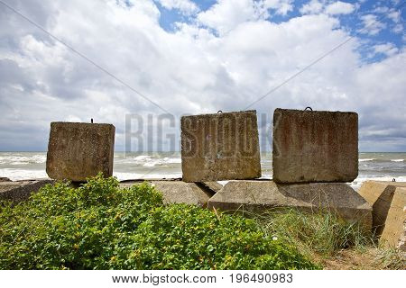 Breakwaters in the Baltic sea at cloudy day, Latvia