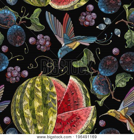 Embroidery hummingbirds plum grapes watermelon seamless pattern. Beautiful classical embroidery tropical birds humming bird fruit watermelons and blossoming plum summer seamless pattern