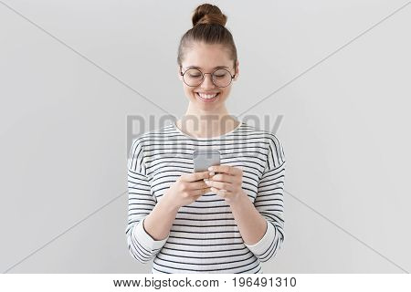 Closeup Photo Of Casually-dressed European Girl Standing Isolated On Gray Background Looking Attenti