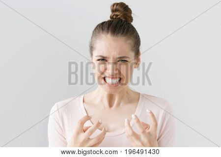 Horizontal Portrait Of Overemotional Fan Girl Isolated On Gray Background Showing Deep Involvement I