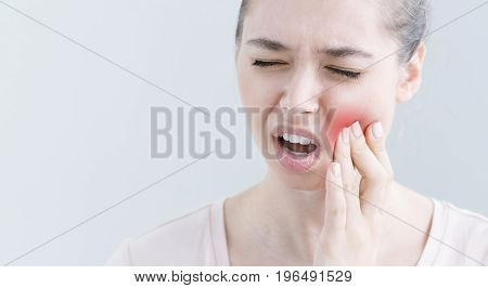 Close Up Portrait Of Young European Female Isolated On Grey Background Suffering From Toothache, Fee