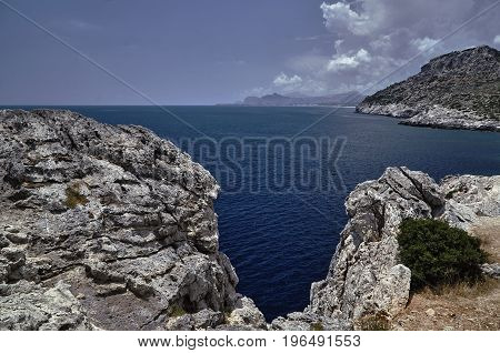 rocky cliff on the seacoast island of Rhodes
