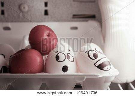 Concept Of Surprise. Eggs In The Refrigerator Near