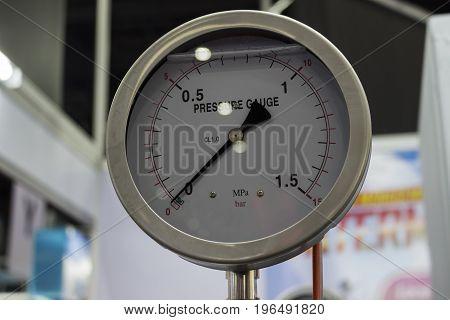 Pressure gauge / gage installed in a machine; close up