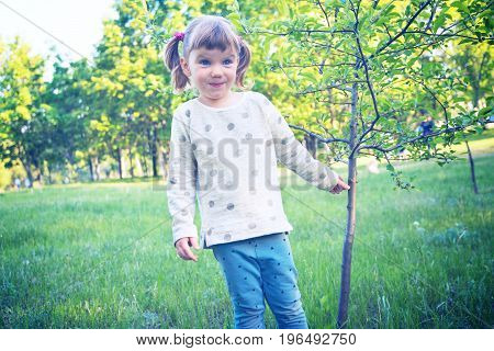Surprised Little Girl Having Fun In A Park