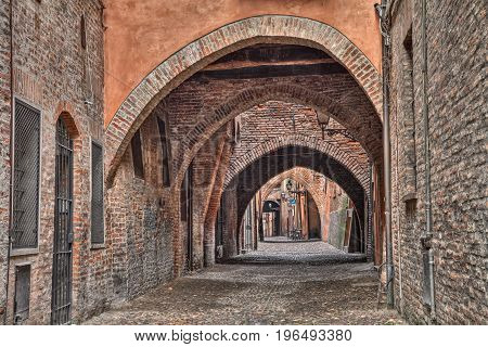 Ferrara, Emilia Romagna, Italy: the picturesque arched alley Via delle Volte, ancient medieval street