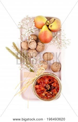 Pear Jam, Pears And Walnuts Are Served On A Light Pink Tray On A White Background Top View..